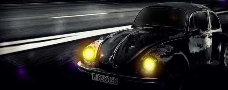 Auto mit leuchtenden Scheinwerfern.jpg
